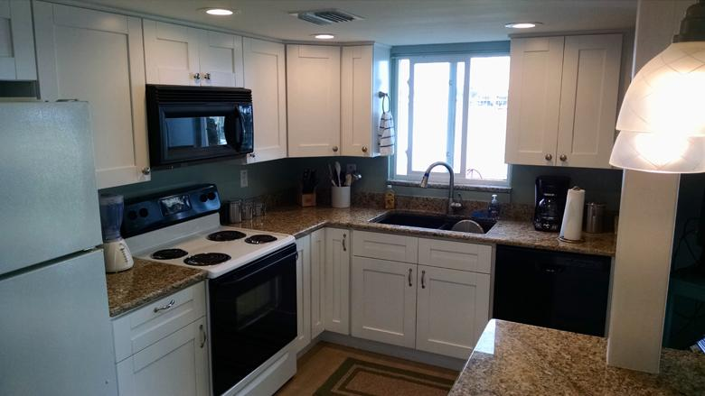 108 Kitchen w/ granite counter tops, dishwasher, microwave, and ice maker